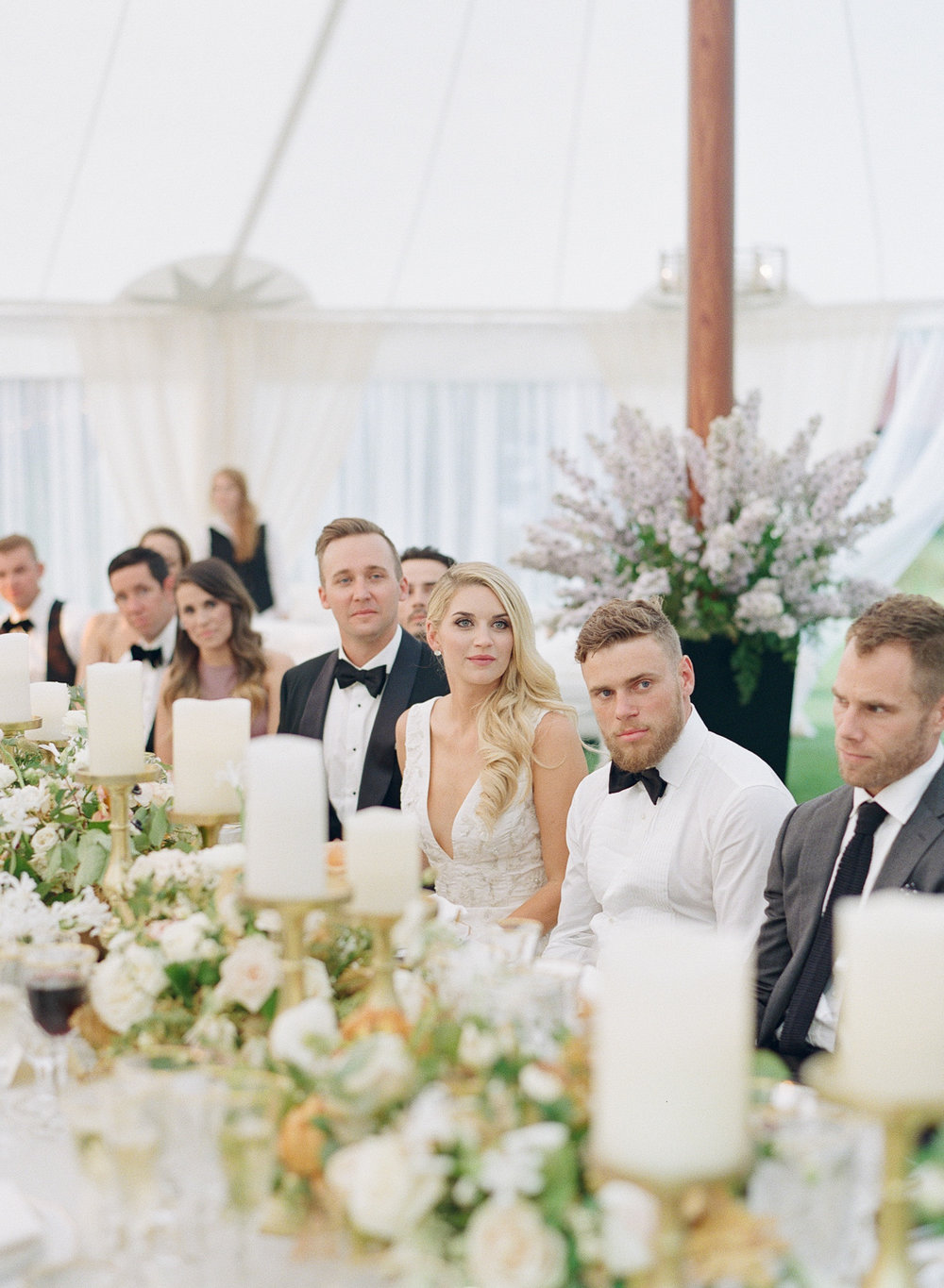 Gus Kenworthy sits with the bride and groom at the wedding reception during toasts; Sylvie Gil Photography