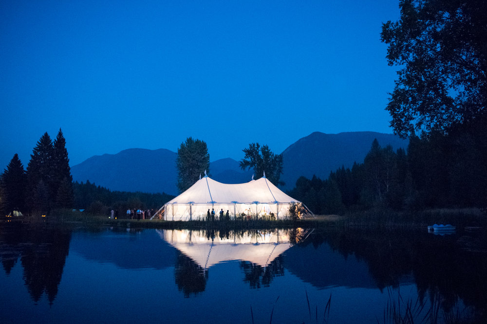 The reception tent, framed by Glacier National Park near Whitefish, Montana; Sylvie Gil Photography