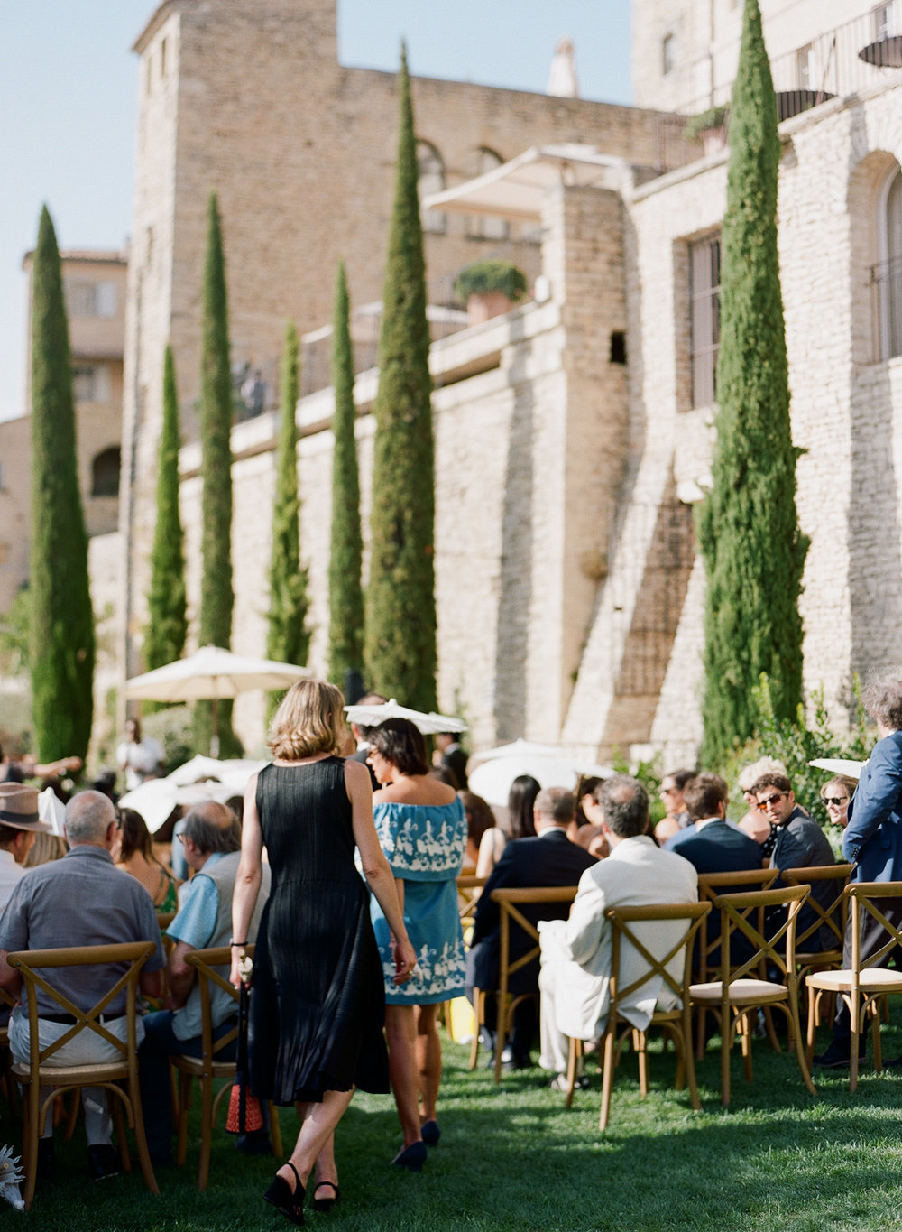 Guests arrive for a wedding in Gordes, Provence, France; Sylvie Gil Photography