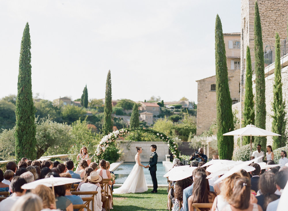 Wedding ceremony at a chateau in Gordes, France; Sylvie Gil Photography