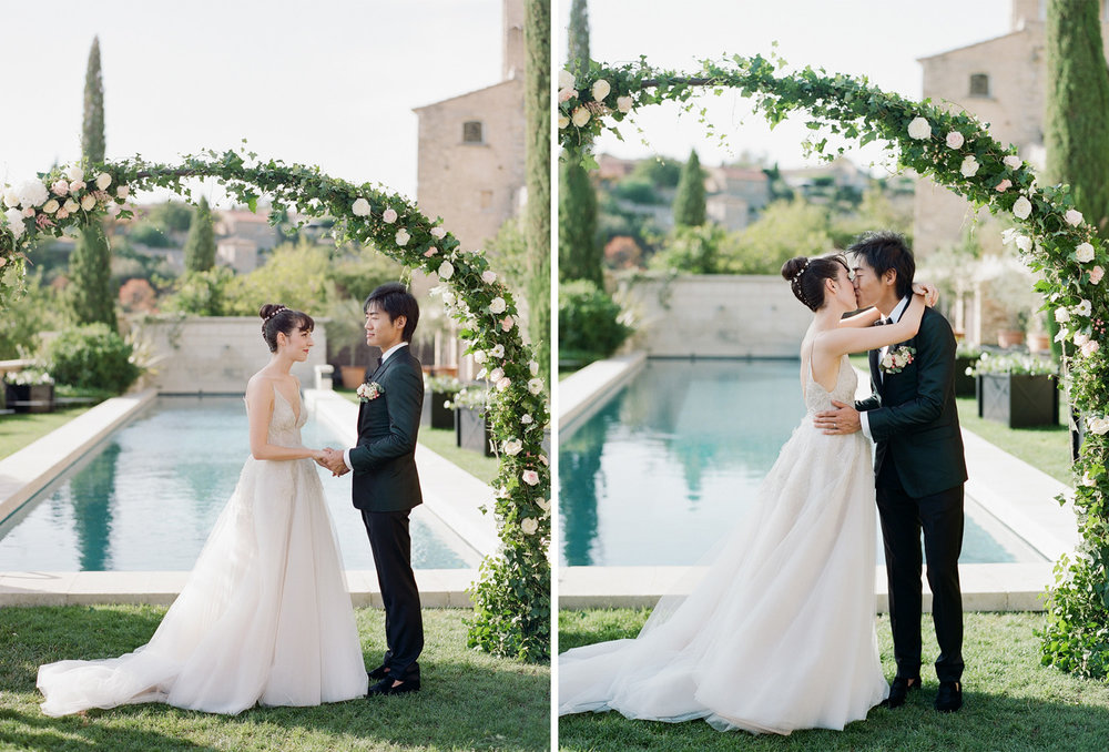 Bride and groom first kiss during a wedding ceremony in Gordes, France; Sylvie Gil Photography