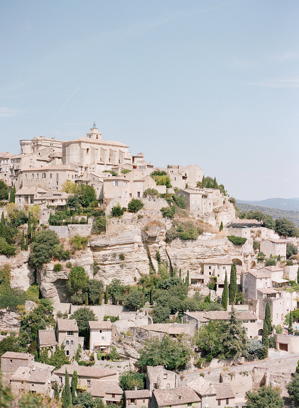 Red tile roofs of the hillside homes in the village of Gordes, France; Sylvie Gil Photography