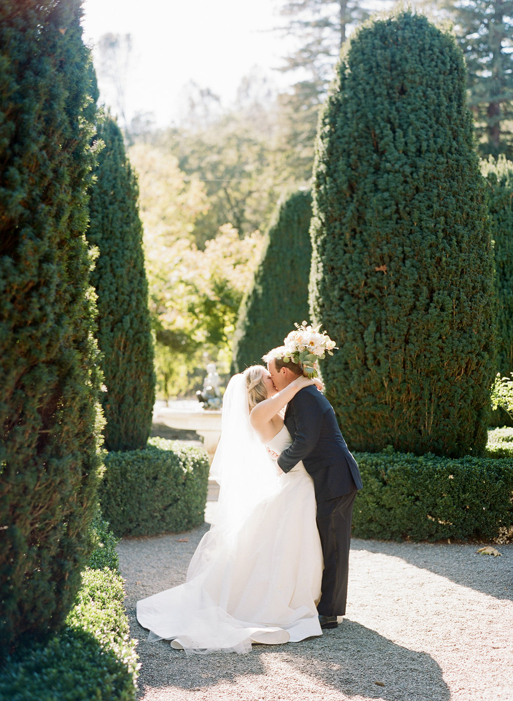 Bride and groom kiss during their first look before the ceremony; Sylvie Gil Photography