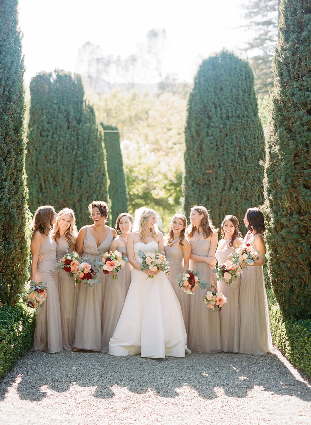 Bridesmaids laugh together in Beaulieu Gardens before the wedding ceremony; Sylvie Gil Photography