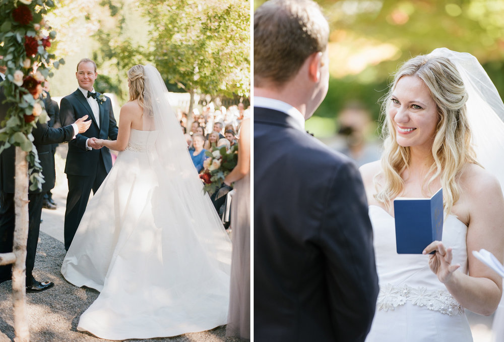 Bride and groom exchange vows at the ceremony in St. Helena wine country; Sylvie Gil Photography