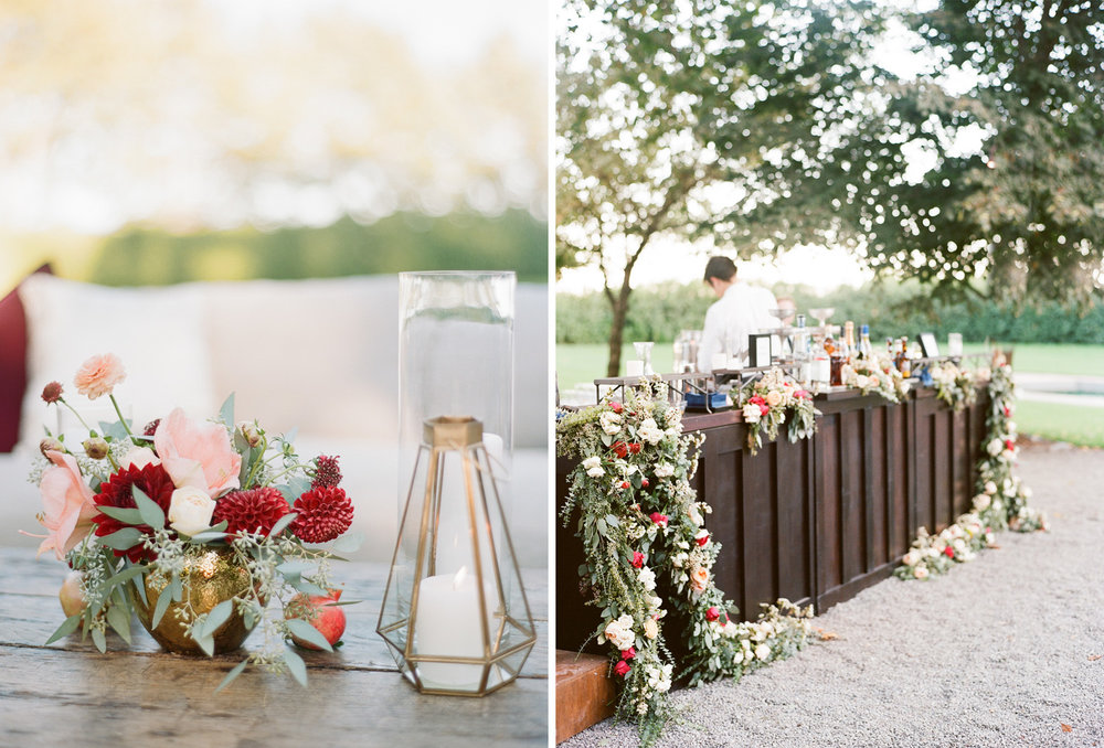 Burgundy and blush floral arrangements and garlands decorate the bar and cocktail tables; Sylvie Gil Photography