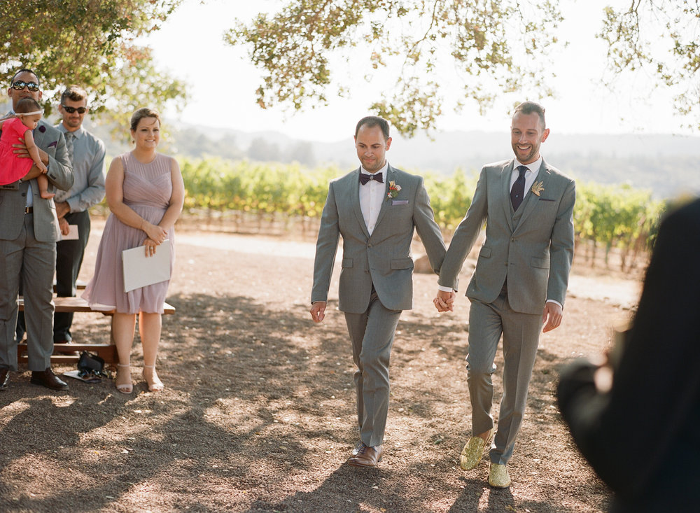 Grooms' processional for their wedding ceremony at Kunde Winery; Sylvie Gil Photography