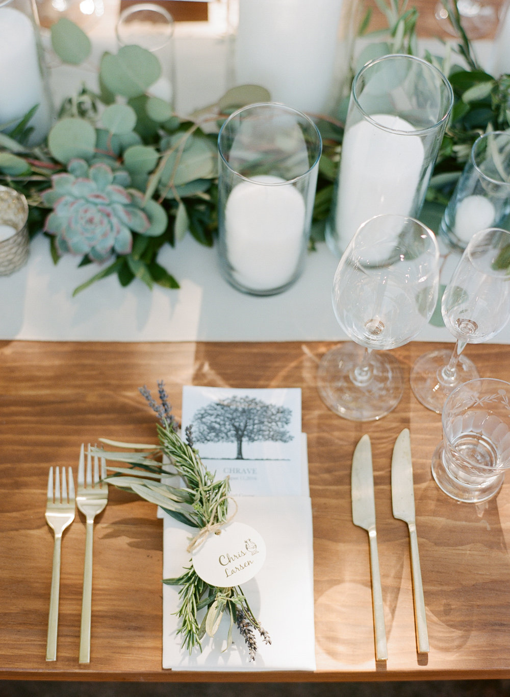 Reception tables decorated with rosemary, lavender, and eucalyptus; Sylvie Gil Photography