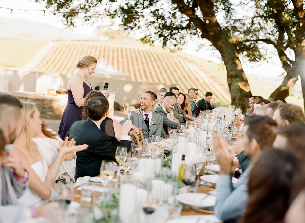 A bridesmaid toasts the couple at a wedding reception at Kunde Winery; Sylvie Gil Photography