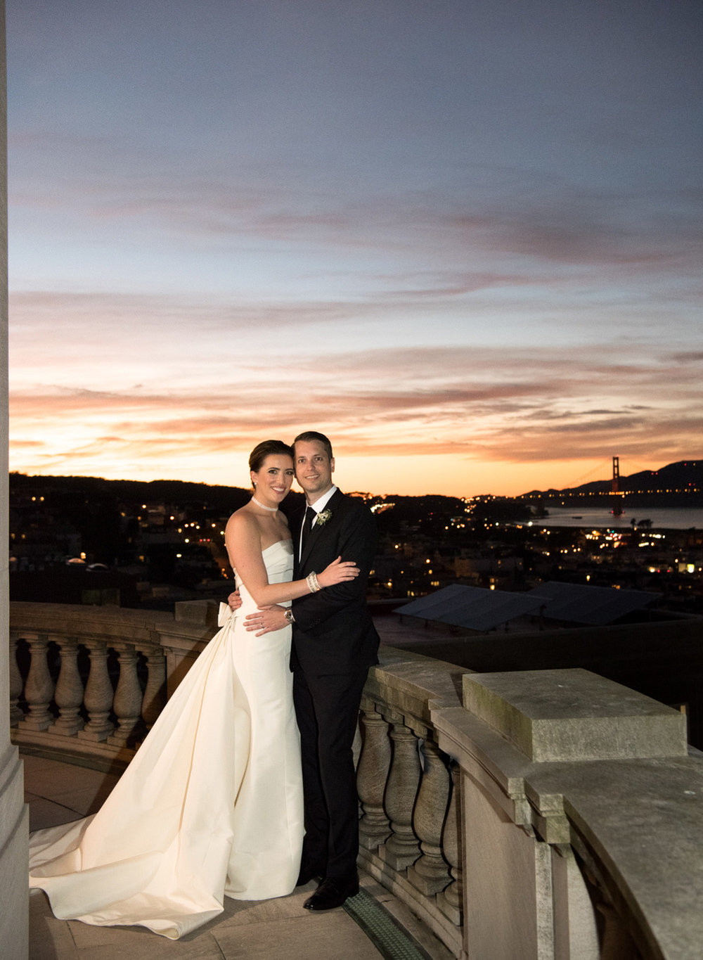 Couple portraits on a balcony at the Flood Mansion in San Francisco at sunset; Sylvie Gil Photography
