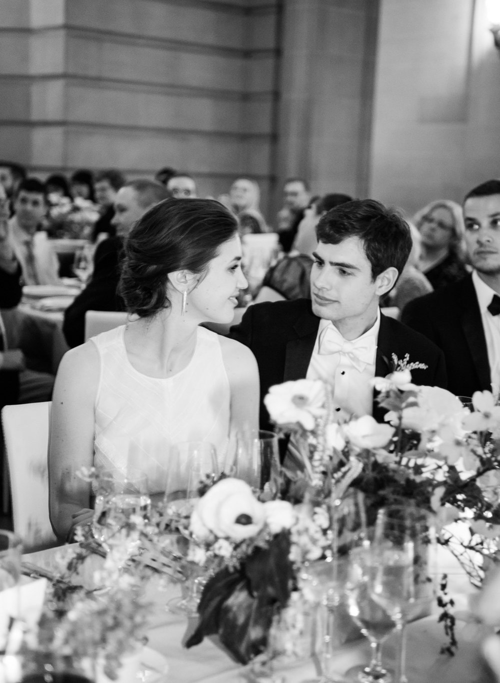 The bride and groom share a smile during their San Francisco City Hall wedding reception; Sylvie Gil Photography
