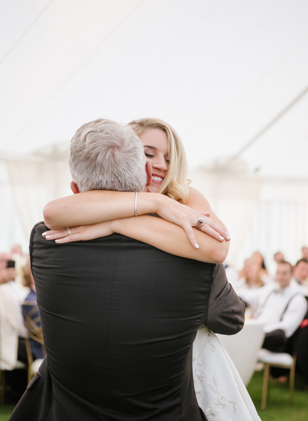 A bride hugs her father during the father daughter dance; Sylvie Gil Photography