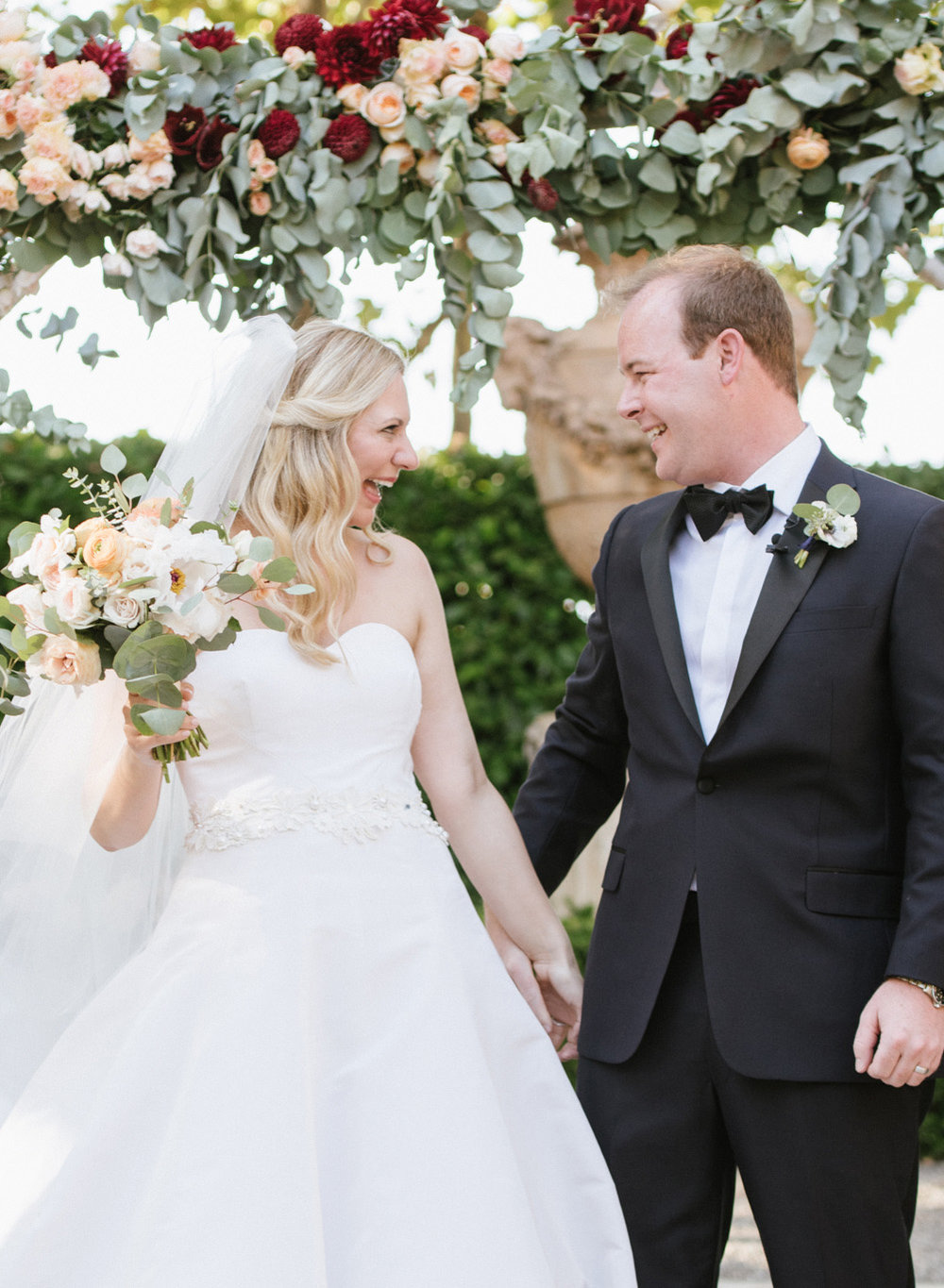 """Bride and groom share a moment right after they say """"I do"""" at Beaulieu Gardens in St. Helena; Sylvie Gil Photography"""