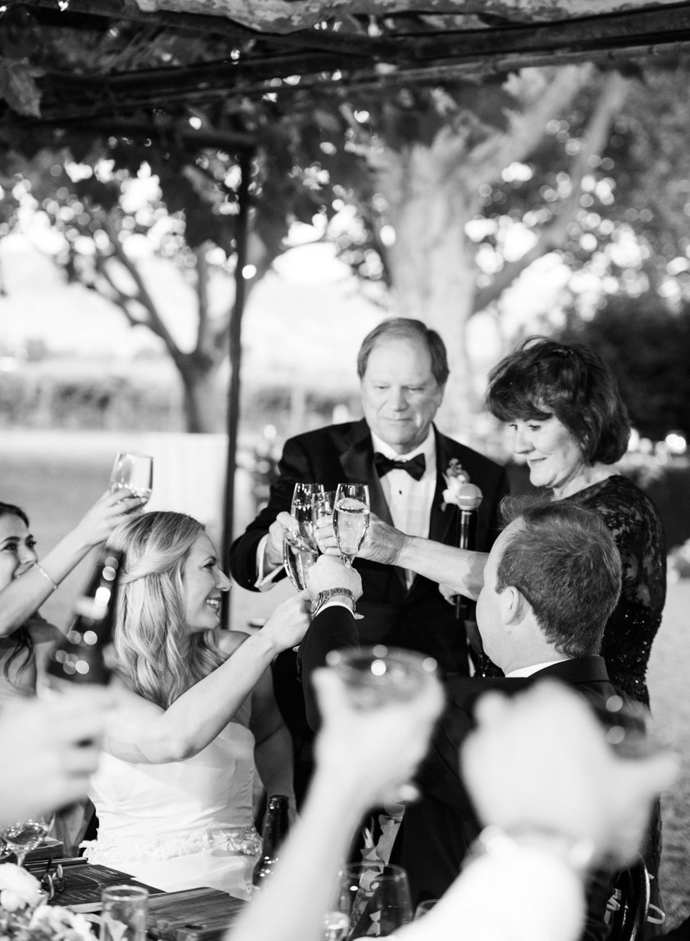 Bride and groom toast their parents during the wedding reception at Beaulieu Gardens in St. Helena; Sylvie Gil Photography