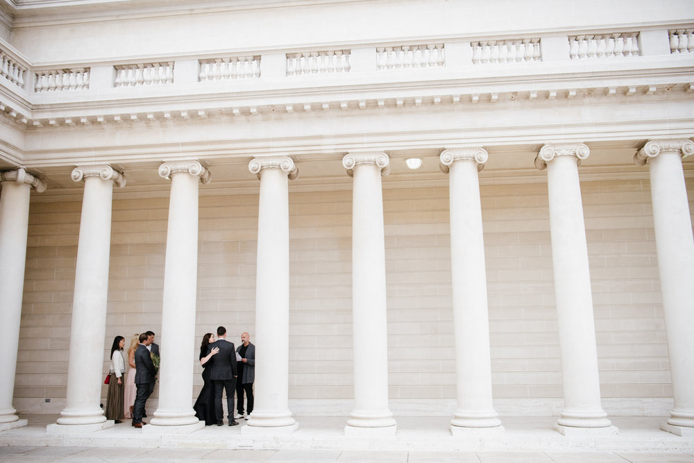 The wedding ceremony among the columns at the Legion of Honor in San Francisco; Sylvie Gil Photography