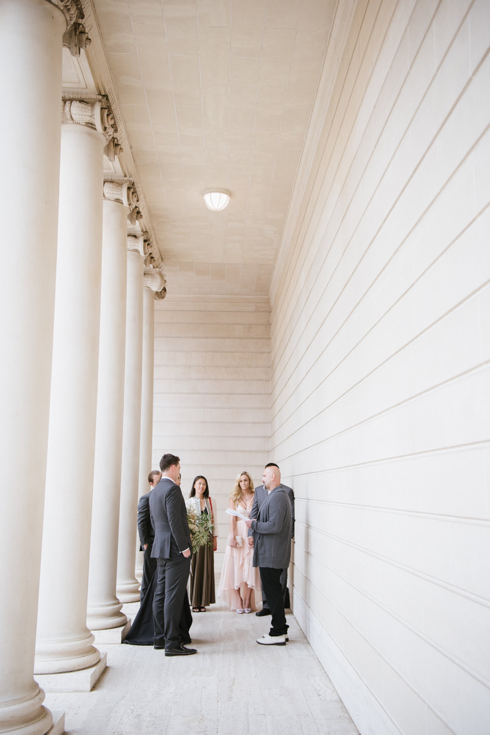 Couple exchanges vows between columns at the Legion of Honor; Sylvie Gil Photography