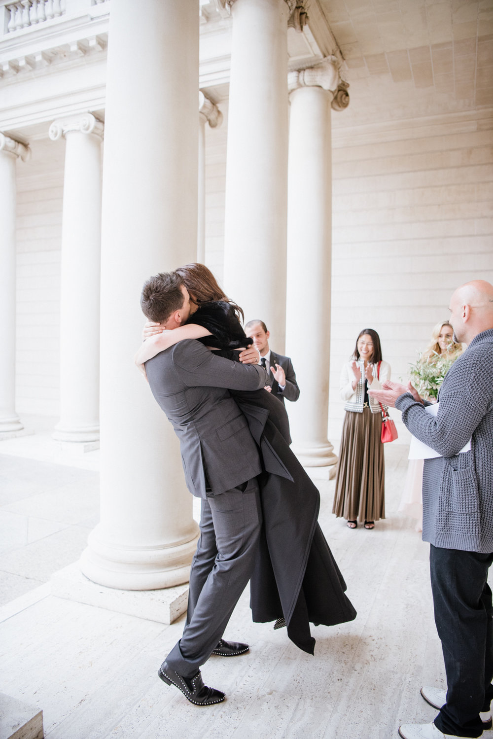 The bride and groom's first kiss during their ceremony at the Legion of Honor; Sylvie Gil Photography