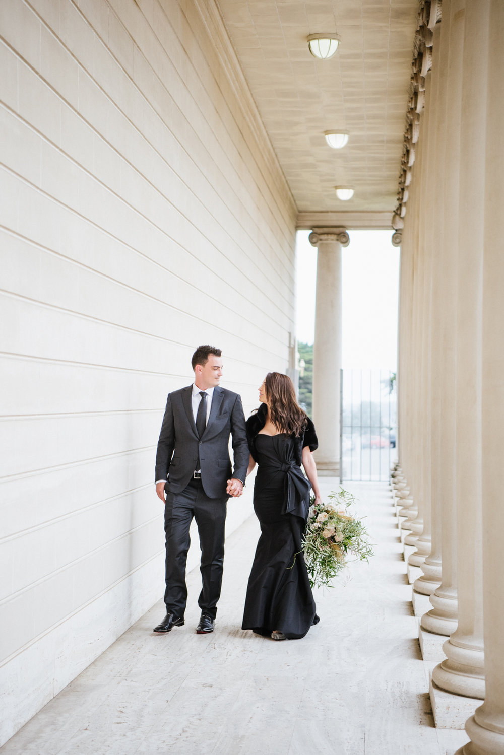 Bride and groom walk through the Legion of Honor, just married; Sylvie Gil Photography