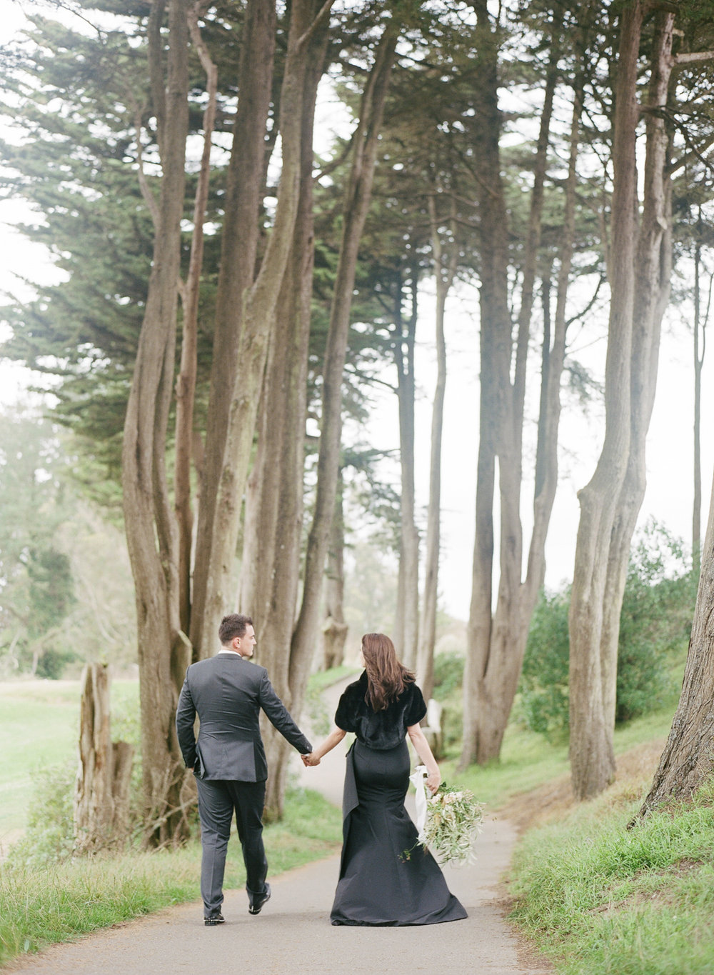 The couple walks through the Presidio after their wedding ceremony at The Legion of Honor; Sylvie Gil Photography