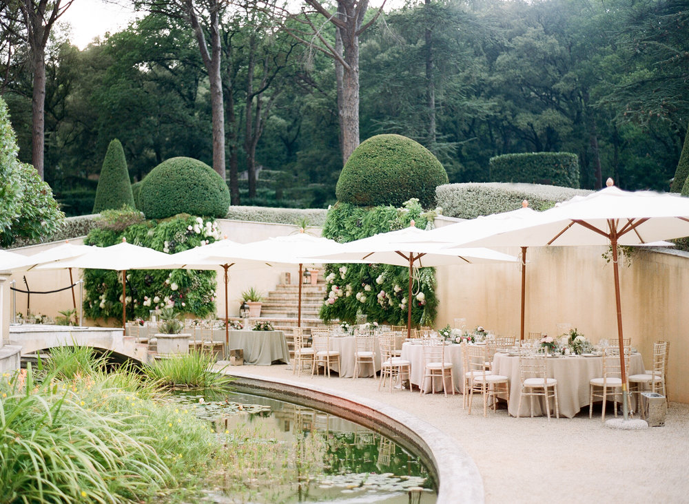 The reception was held in the chateau gardens near a lily pond; Sylvie Gil Photography