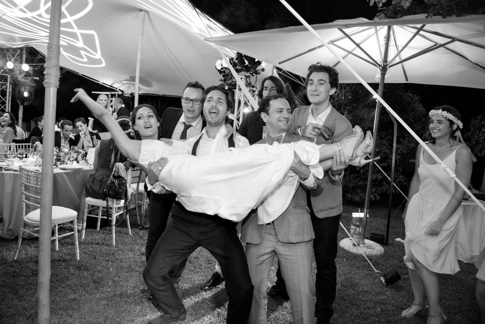 Groomsmen goof around at the reception in Provence, France; Sylvie Gil Photography