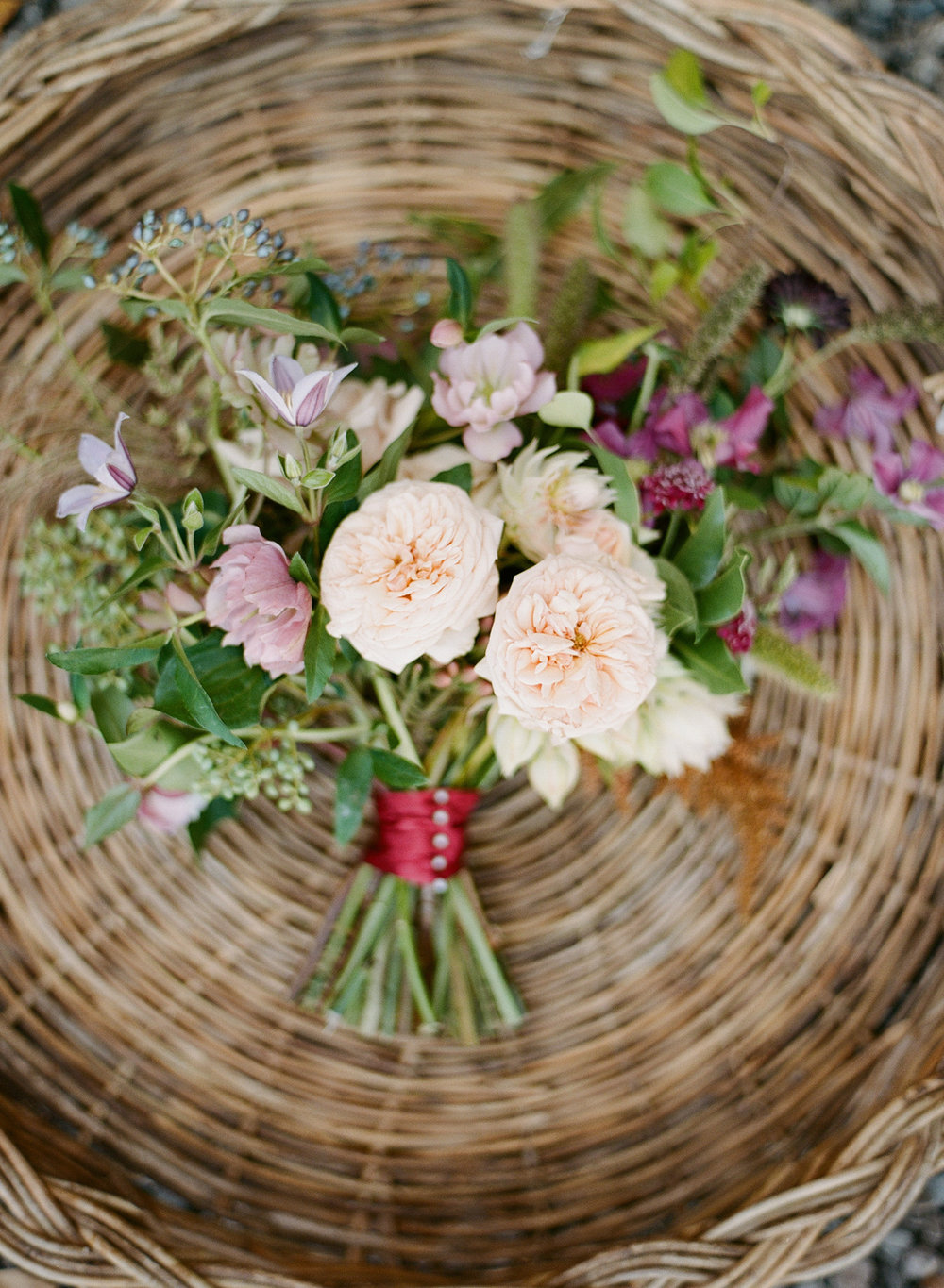 Blush and lilac blooms in a rustic bouquet; Sylvie Gil Photography