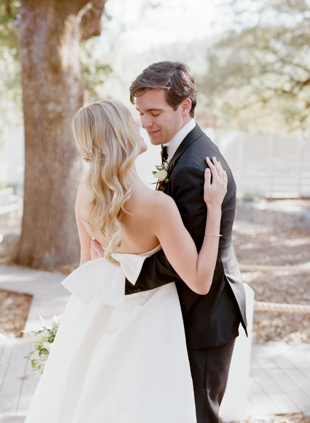Bride and groom share a kiss during their first look at Durham Ranch in Napa Valley; Sylvie Gil Photography