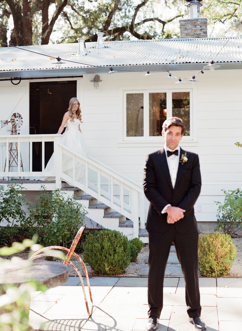 The groom waits for his bride for the first look at Durham Ranch; Sylvie Gil Photography