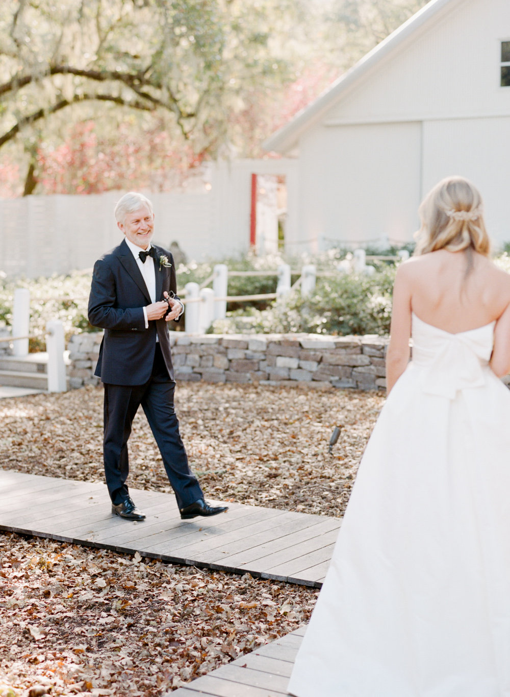The bride's father greets her on her wedding day at Durham Ranch in St. Helena, California; Sylvie Gil Photography