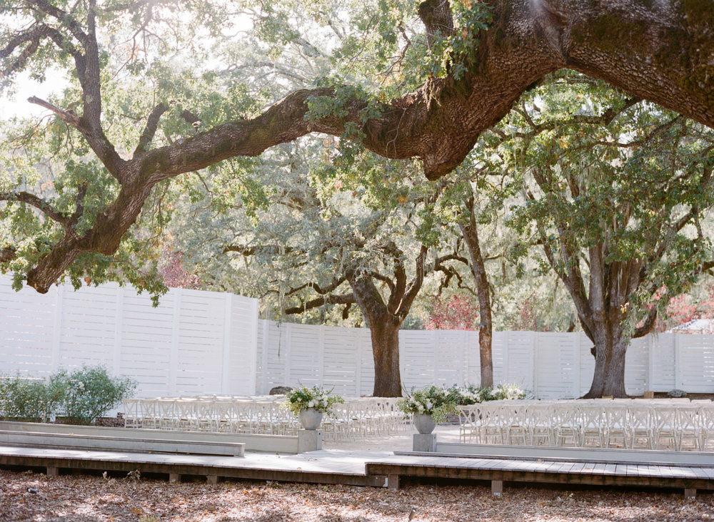 A ceremony space under oak trees at Durham Ranch in St. Helena; Sylvie Gil Photography