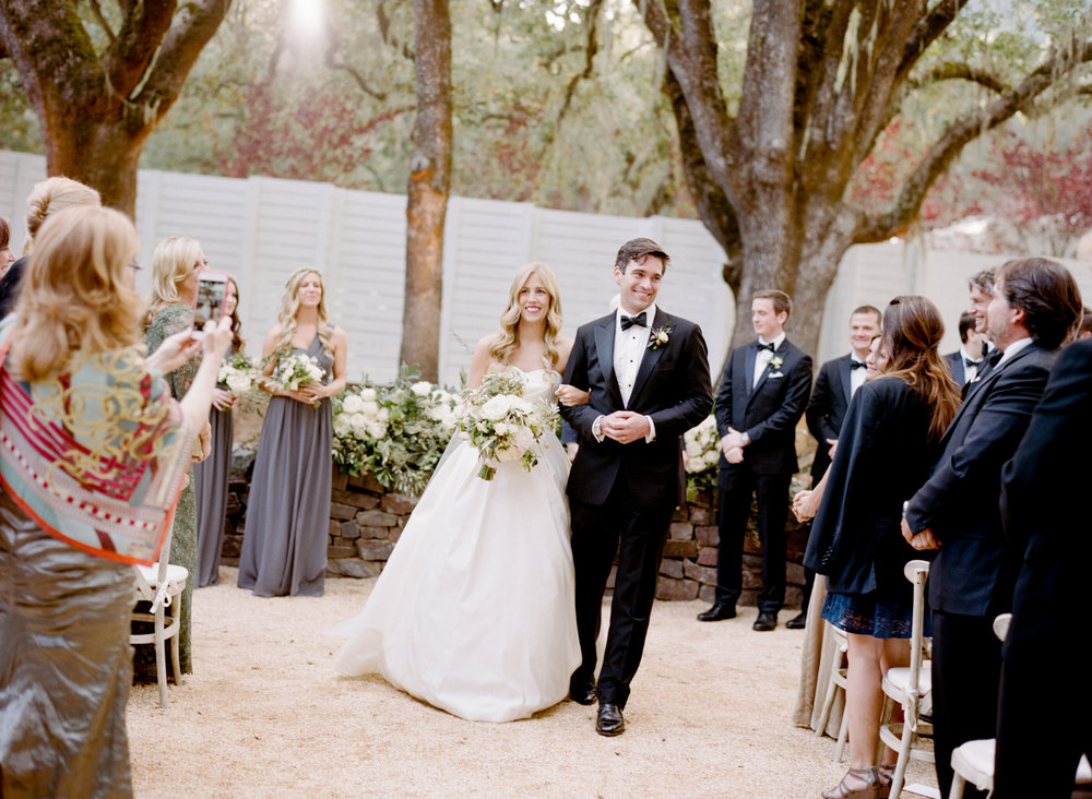 Bride and groom walk down the aisle just married after a ceremony at Durham Ranch in St. Helena; Sylvie Gil Photography