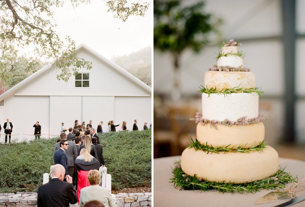 """A wedding """"cake"""" made from stacked wheels of cheese decorated with rosemary and lavender sprigs; Sylvie Gil Photography"""