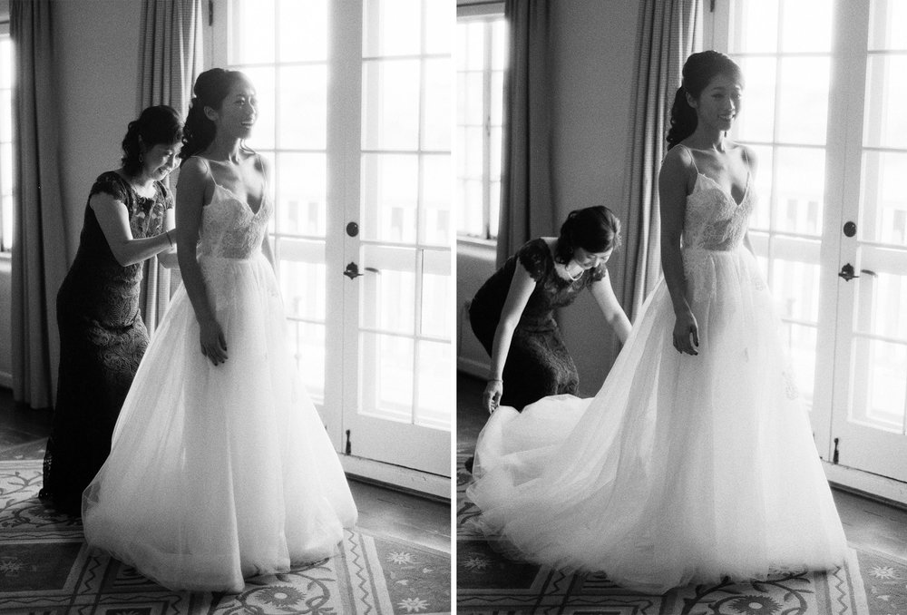 The bride's mother helps her into her Monique Lhuillier gown on her wedding ceremony morning; Sylvie Gil Photography