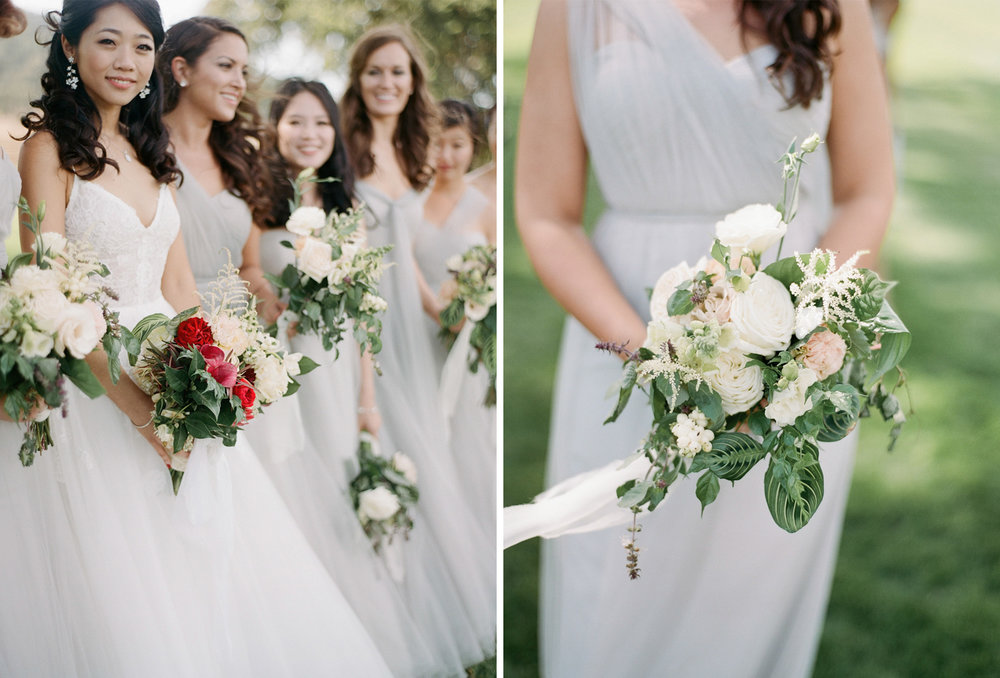 The bride stands with her bridesmaids, in slate grey gowns and neutral, blush bouquets; Sylvie Gil Photography