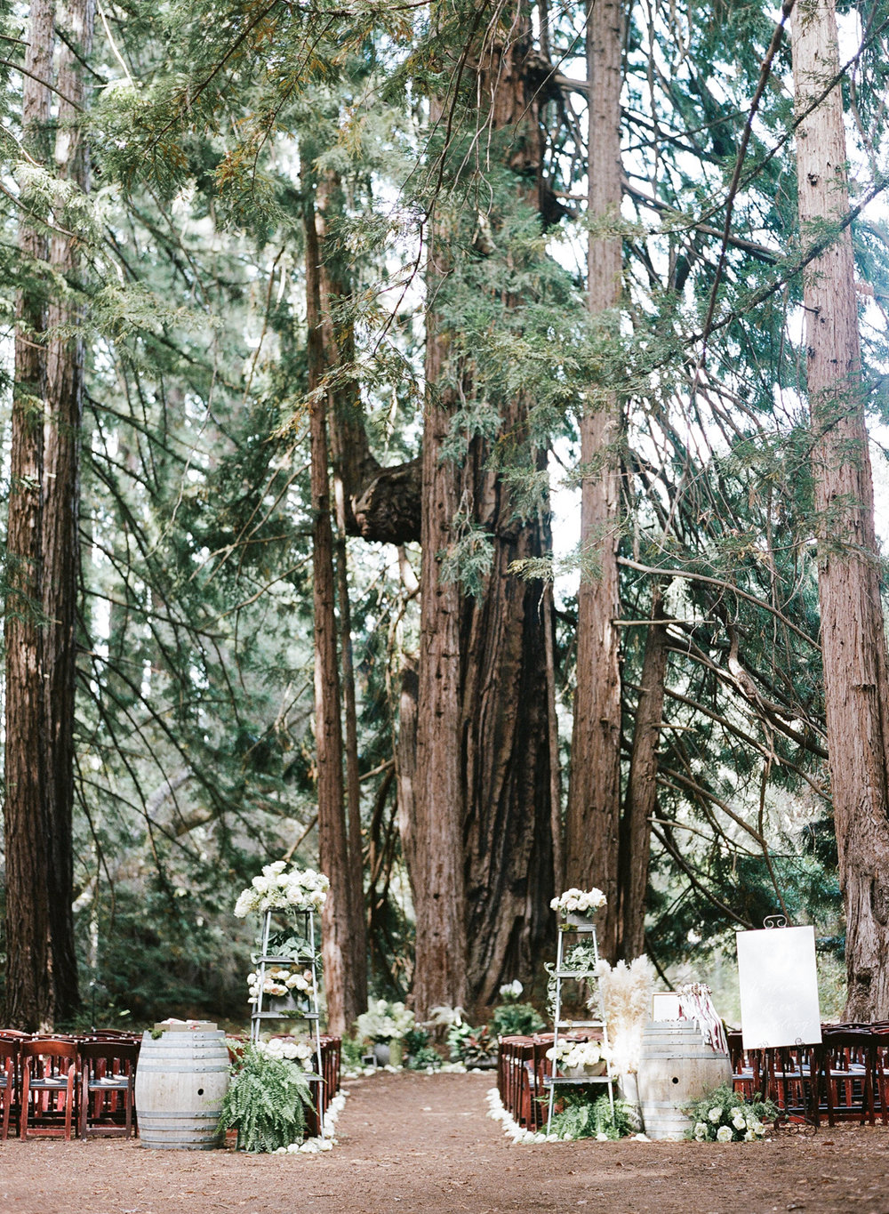 A forest wedding ceremony among the redwoods in Santa Lucia Preserve in Carmel, California; Sylvie Gil Photography