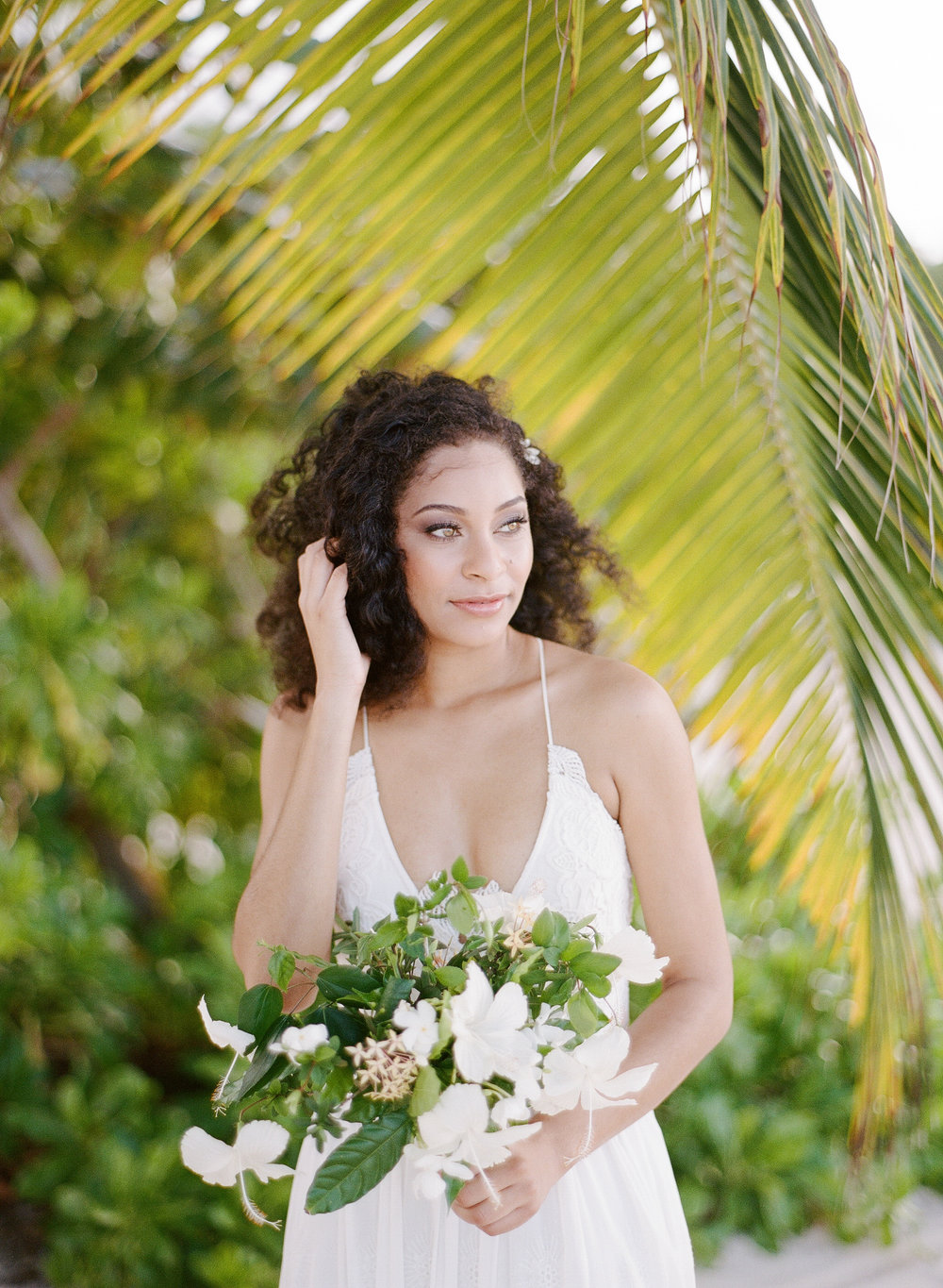 A beautiful Jamaican bride in an editorial shoot on the beach in Montego Bay, Jamaica; Sylvie Gil Photography