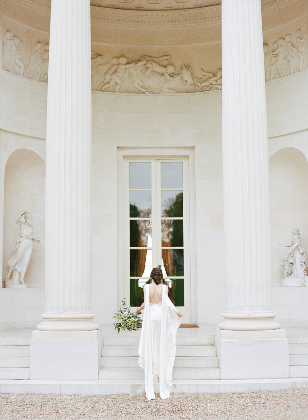 A bride walks up the steps to Pavillon de la Musique in Paris, France; Sylvie Gil Photography
