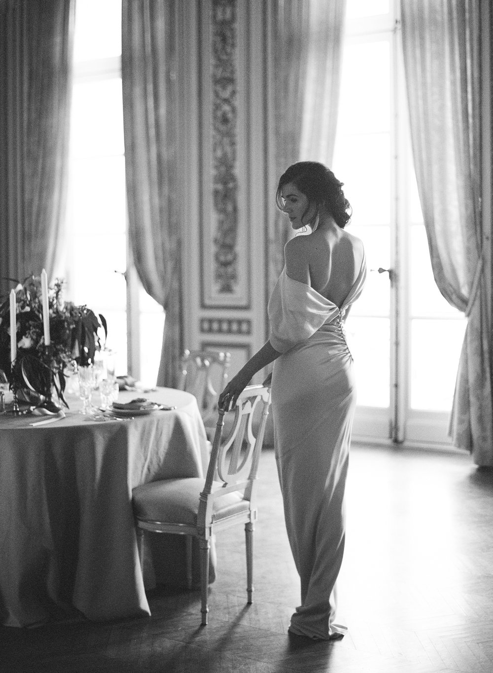 A bride walks past an intimate reception table at Pavillon de la Musique in Paris, France; Sylvie Gil Photography