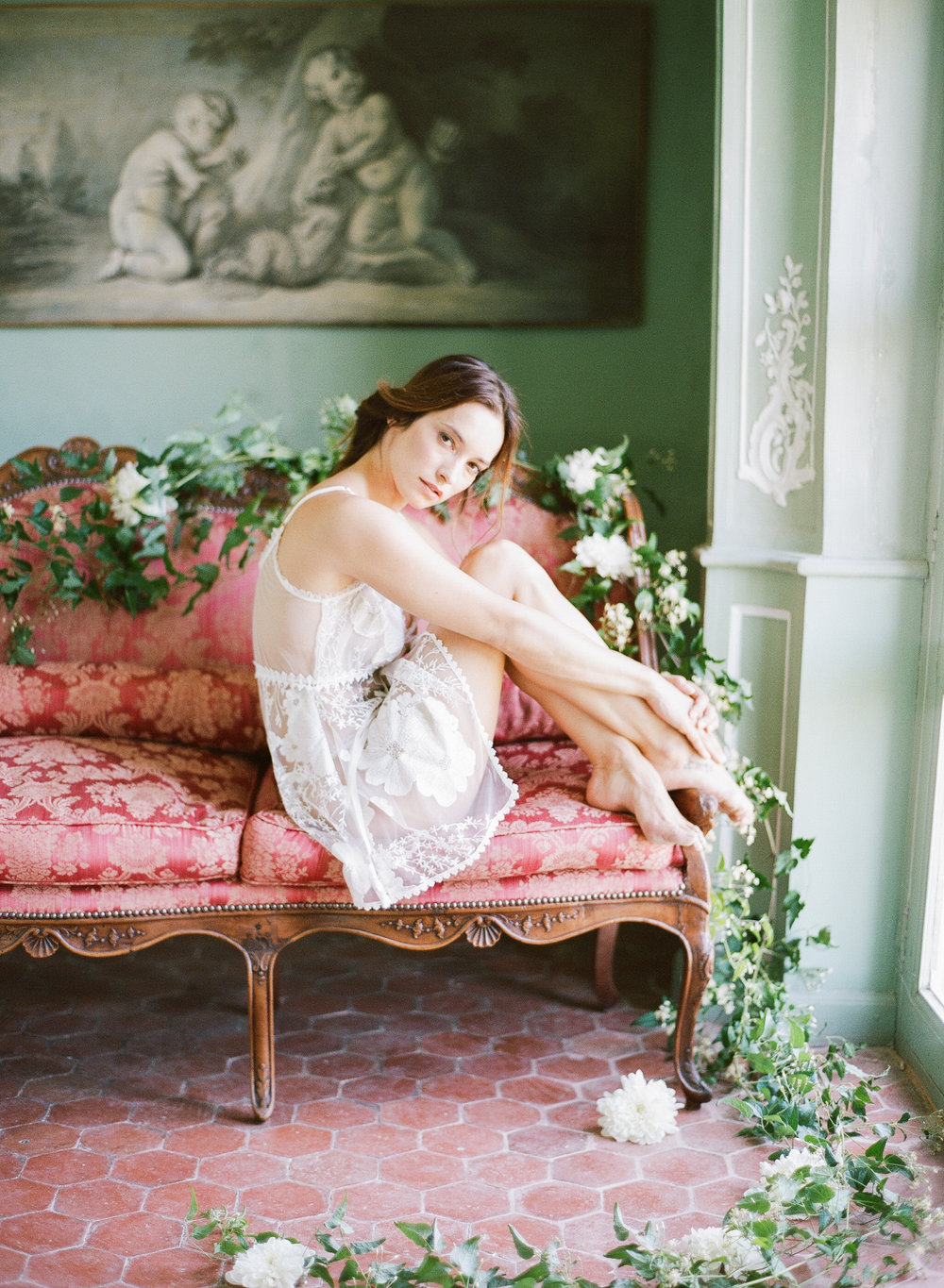 A boudoir session with a bride on a vintage couch in Provence, France; Sylvie Gil Photography