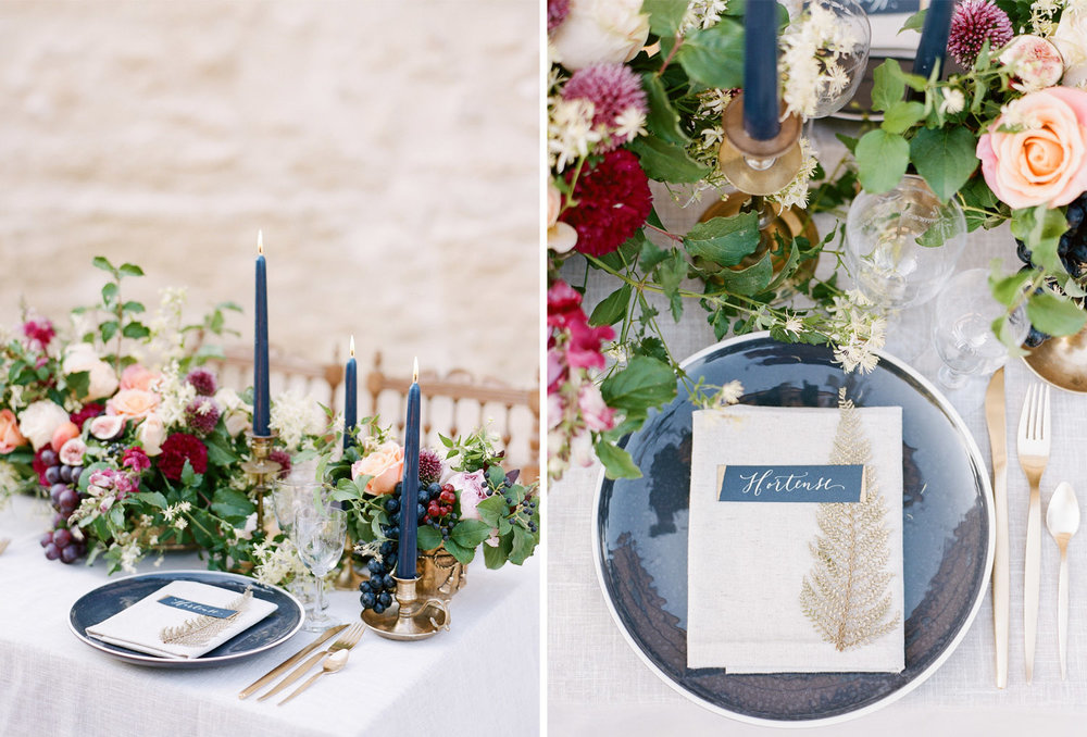 Beach and burgundy florals, along with fresh grapes and figs decorate a wedding reception table in Provence, France; Sylvie Gil Photography