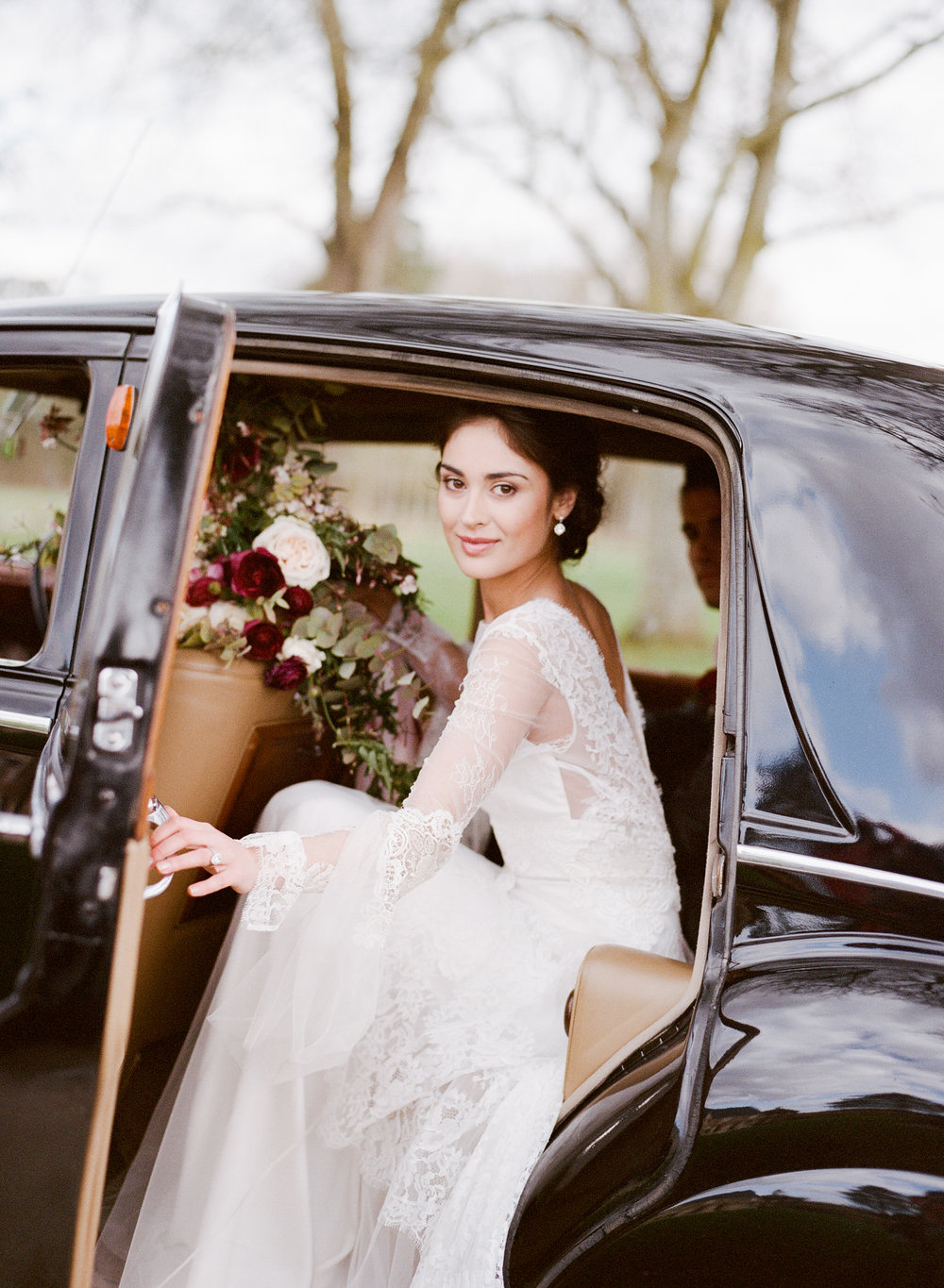 A bride gets into a vintage car after her wedding in Burgundy, France; Sylvie Gil Photography