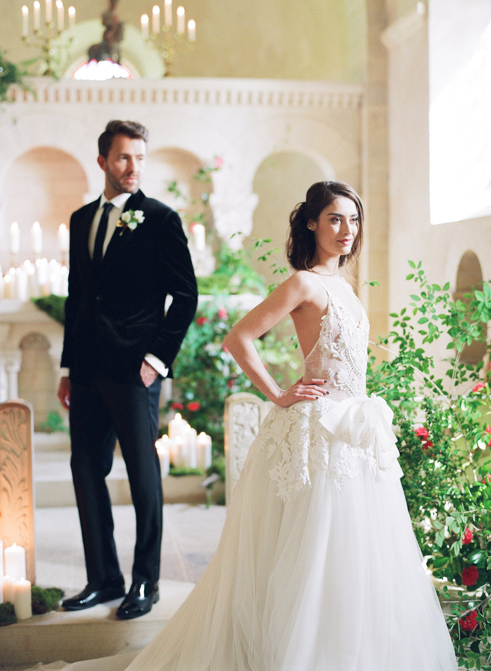 Bride and groom during a wedding ceremony in a chapel at Chateau de Varennes; Sylvie Gil Photography