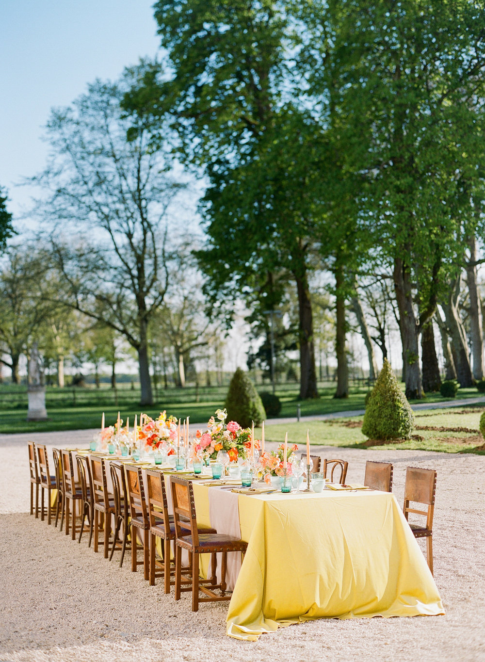 A bright jewel-toned wedding reception table at Chateau de Varennes; Sylvie Gil Photography