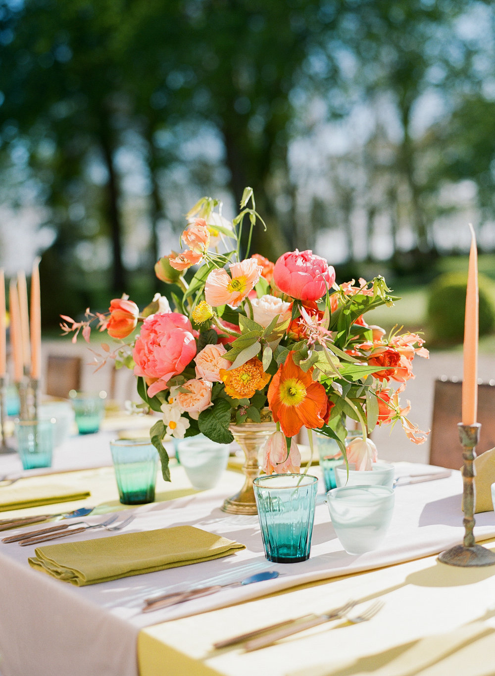 Jewel-toned glassware and florals at a Burgundy wedding reception; Sylvie Gil Photography