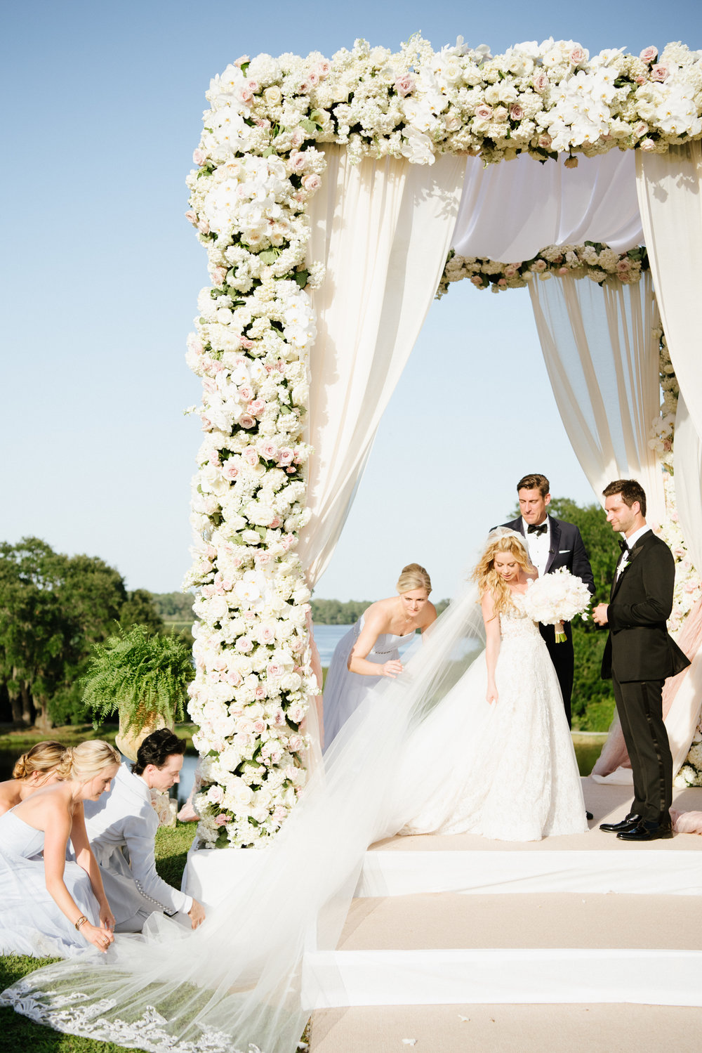 Johnny Weir helps Tara Lipinski with her veil on her wedding day; Sylvie Gil Photography
