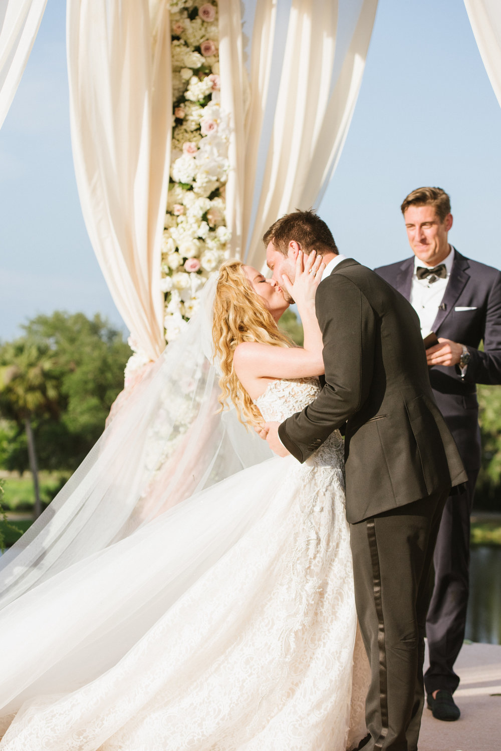 Tara Lipinski and Todd Kapostasy have their first kiss, just married in Charleston, South Carolina; Sylvie Gil Photography