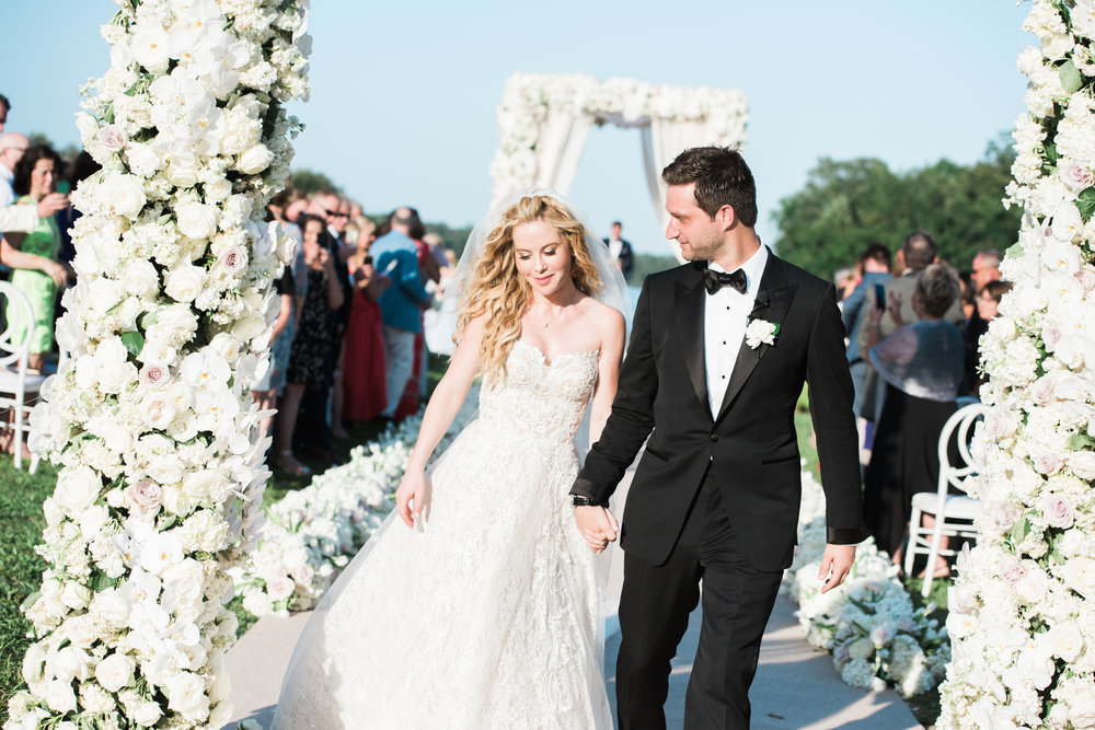 Tara Lipinski and Todd Kapostasy walk down the aisle just married; Sylvie Gil Photography