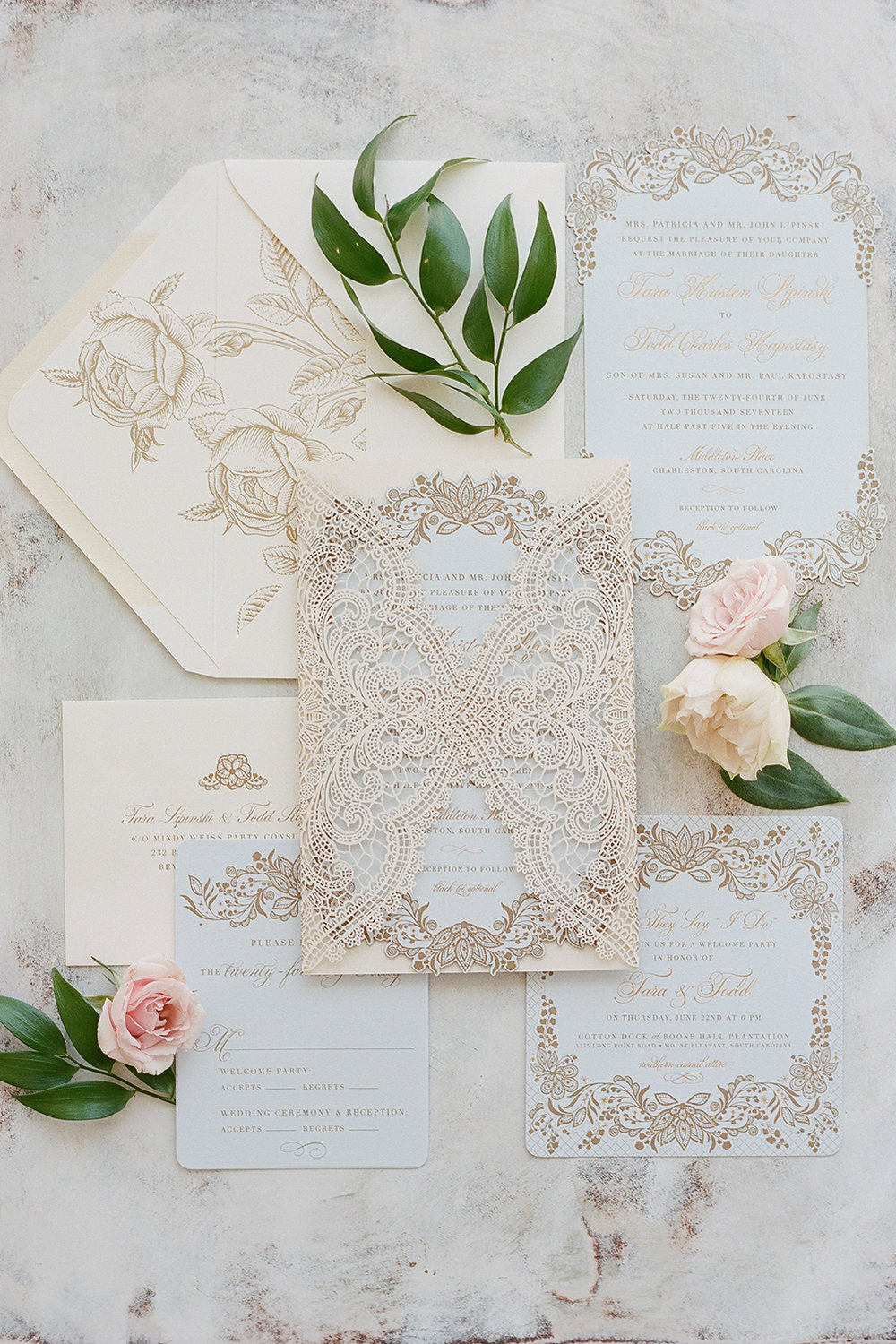 A gorgeous Southern lace and baby blue invitation suite for Tara Lipinski's and Todd Kapostasy's wedding; Sylvie Gil Photography