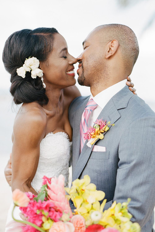 Couple shares a laugh after their Montego Bay beach wedding; Sylvie Gil Photography