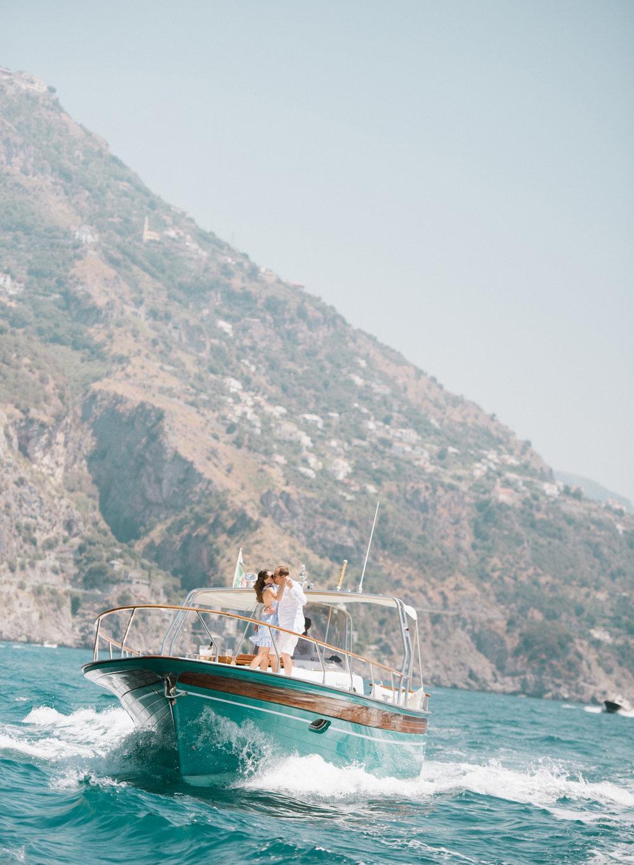 Bride and groom dance on a yacht near Positano on the Amalfi Coast in Italy; Sylvie Gil Photography